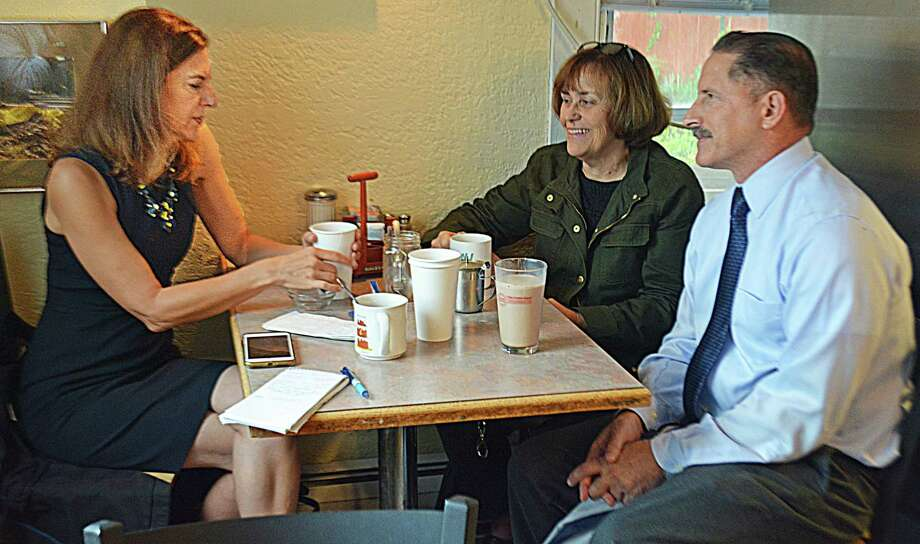 Lieutenant governor candidate Susan Bysiewicz of Middletown, left, had coffee at Sarah's Place on Main Street in Portland with fellow Democrats Susan Bransfield, first selectman of Portland, center; and (not pictured) Essex First Selectman Norm Needleman, candidate for the 33rd Senate District; and Laurel Steinhauser, who is running against state Rep. Christie Carpino in the 34th House District. Photo: Cassandra Day / Hearst Connecticut Media