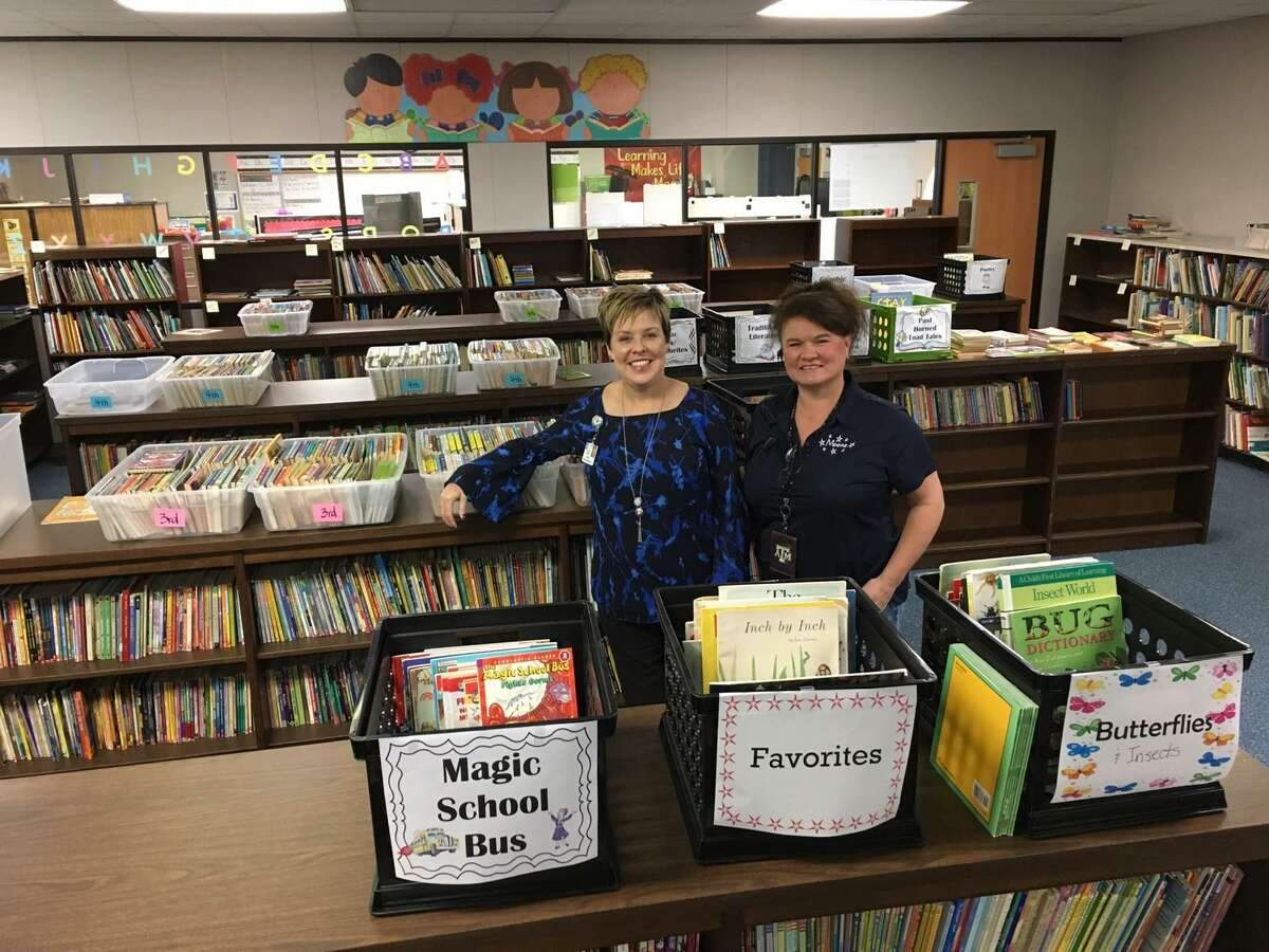 The library at Moore Elementary School was a total loss after floodwaters following Hurricane Harvey. The school had to be housed at the old Matzke Elementary School, 13102 Jones Road, in 2017 and still had a room full of books thanks to donations and the efforts of school librarian Kim Katz. From left are Moore Elementary Principal Patricia Myers and Katz.