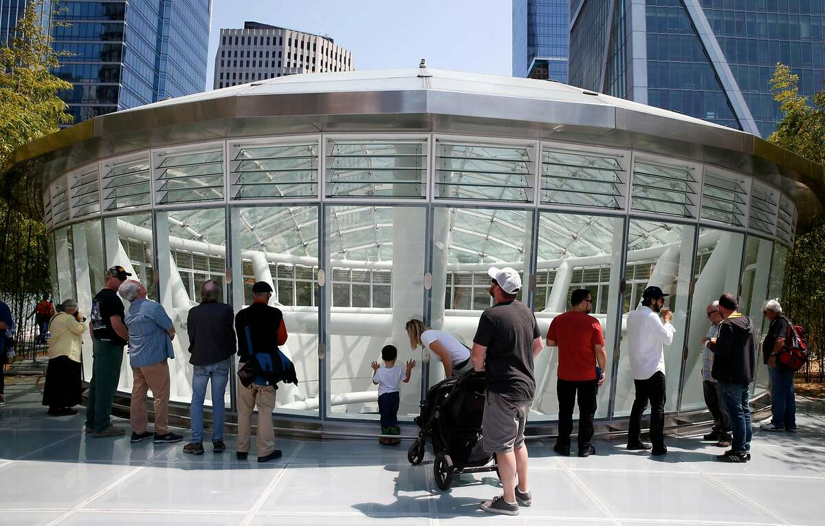 Visitors peer down into the oculus from the roof during the grand opening of the Salesforce Transit Center in San Francisco, Calif. on Saturday, Aug. 11, 2018. Buses begin rolling through the terminal Sunday.