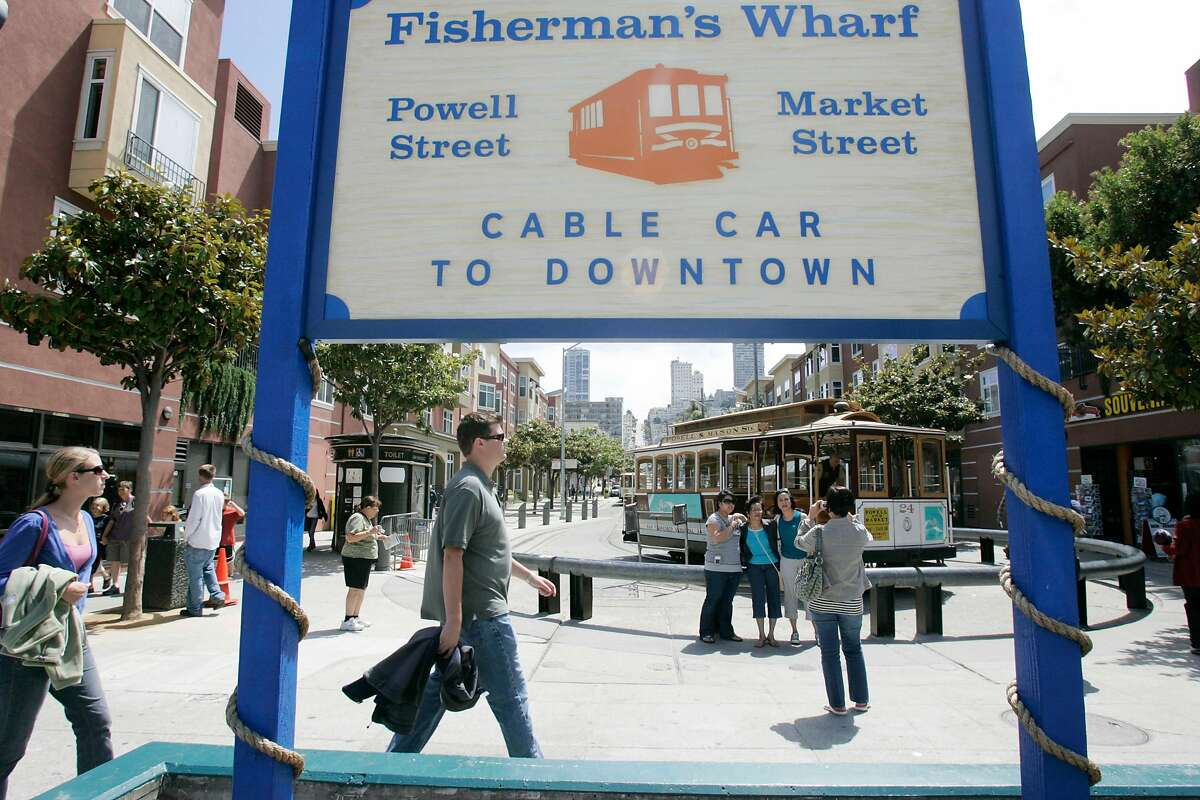 Tourists and pedestrians mix at the end of the Powell-Mason cable car line in San Francisco's Fisherman's Wharf, Thursday, Sept., 18, 2008. (AP Photo/Marcio Jose Sanchez)