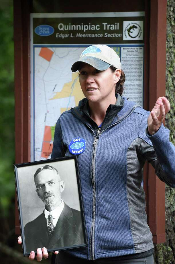 Clare Cain, trails stewardship director for the Connecticut Forest & Park Association, holds a portrait of Edgar L. Heermance as she speaks during the dedication of the Edgar L. Heermance Section of the Quinnipiac Trail off of Rocky Top Rd. in Hamden on September 28, 2018. Photo: Arnold Gold / Hearst Connecticut Media / New Haven Register