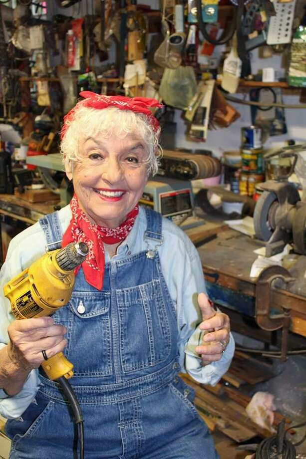 Western Connecticut State University professor and historical reenactor Darla Shaw, in her Rosie the Riveter costume. Photo: Contributed /