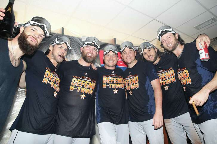Houston Astros players celebrate in the clubhouse after the Astros clinched the American League West division title after their MLB game against the Toronto Blue Jays at Rogers Centre on Wednesday in Toronto.