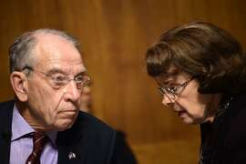 US Senate Judiciary Committee chair Chuck Grassley (L) (R-IA) speaks with Democratic US Senator Dianne Feinstein during a hearing on Capitol Hill in Washington, DC on September 28, 2018, on the nomination of Brett M. Kavanaugh to be an associate justice of the Supreme Court of the United States. - Kavanaugh's contentious Supreme Court nomination will be put to an initial vote Friday, the day after a dramatic Senate hearing saw the judge furiously fight back against sexual assault allegations recounted in harrowing detail by his accuser. (Photo by Brendan SMIALOWSKI / AFP)BRENDAN SMIALOWSKI/AFP/Getty Images