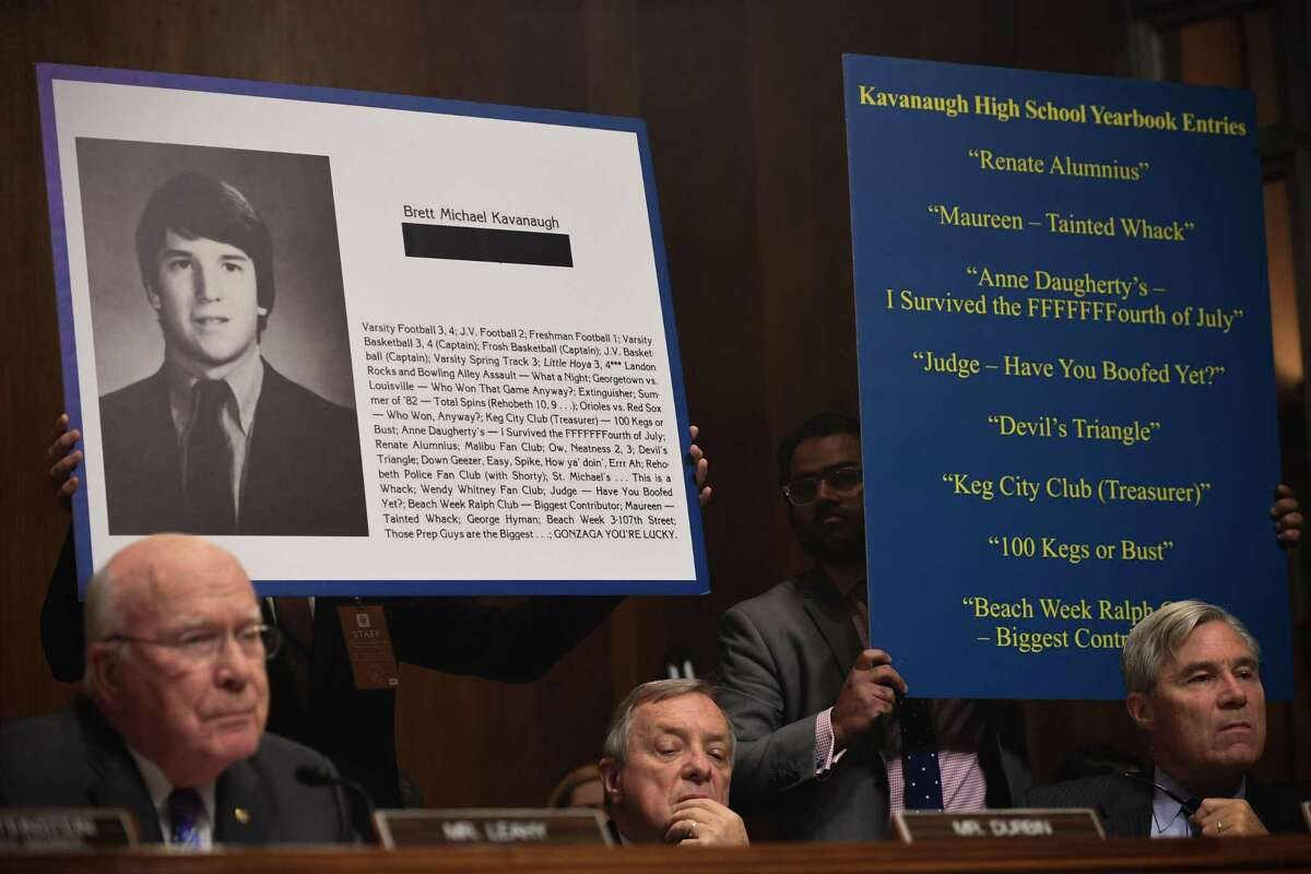 Extracts of his high school yearbook are displayed as Supreme Court nominee Brett Kavanaugh testifies before the US Senate Judiciary Committee on Capitol Hill in Washington, DC, September 27, 2018. (Photo by SAUL LOEB / POOL / AFP)SAUL LOEB/AFP/Getty Images