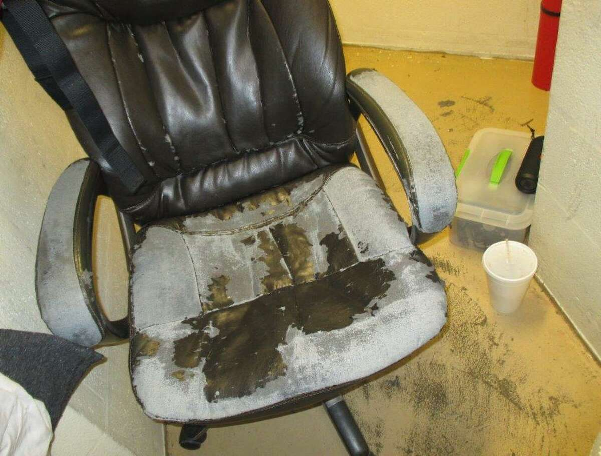 A chair found in the Bexar County jail, one of many in similar condition, which looks to have seen better days.