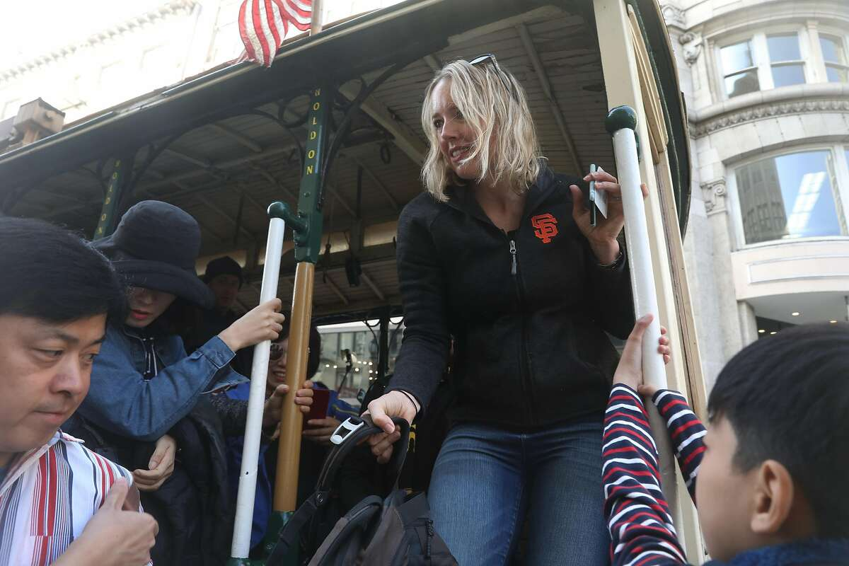 Heather Knight steps off a cable car on the way to the first stop at the Clift Hotel for Tourist Trap Day on Wednesday, September 26, 2018 in San Francisco, Calif.