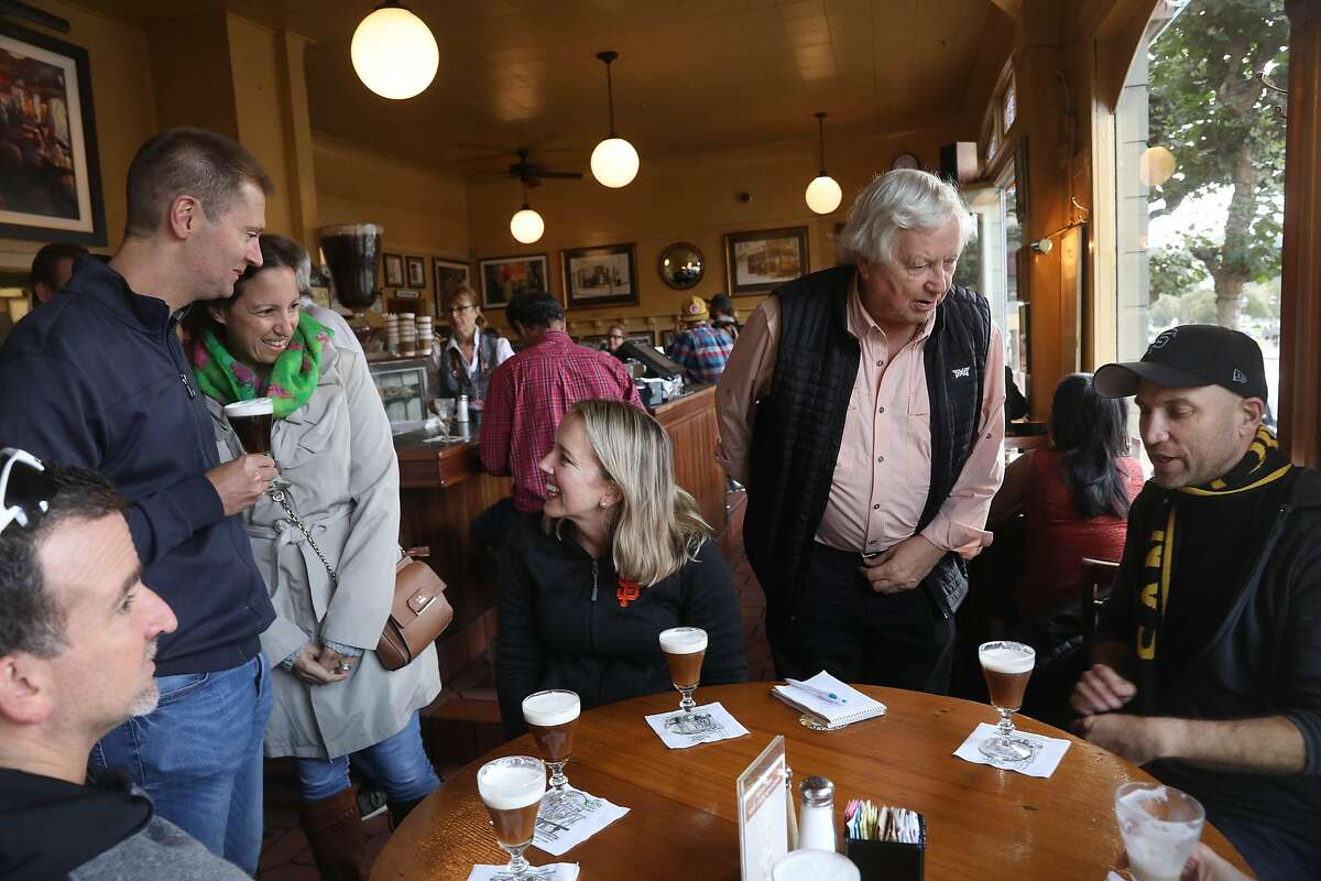 Heather Knight (third from right) talks with William Wemore (second from left) and Shireen Wetmore (third from left) as Peter Hartlaub (right) talks with Bob Freeman, owner The Buena Vista ( second from right) and others joining them for their arrival at the final stop at The Buena Vista on Tourist Trap Day on Wednesday, September 26, 2018 in San Francisco, Calif.