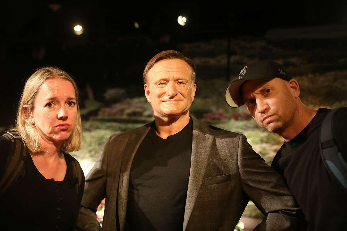 Heather Knight (l to r) and Peter Hartlaub pose for a portrait with a wax figure of Robin Williams at Madame Tussauds Wax Museum for Tourist Trap Day on Wednesday, September 26, 2018 in San Francisco, Calif.