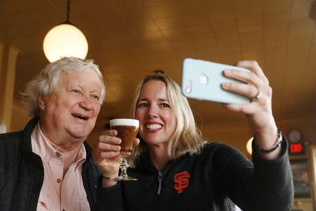 Heather Knight (right) takes a photo with Bob Freeman (left), owner The Buena Vista at the final stop at The Buena Vista on Tourist Trap Day on Wednesday, September 26, 2018 in San Francisco, Calif. Photo: Lea Suzuki / The Chronicle