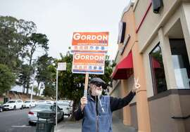 Ralph Lane, supporter of District 4 Board of Supervisor candidate Gordon Mar, waves to cars and pedestrians while campaigning for Mar in the Sunset district of San Francisco, Calif. Saturday, Sept. 15, 2018.