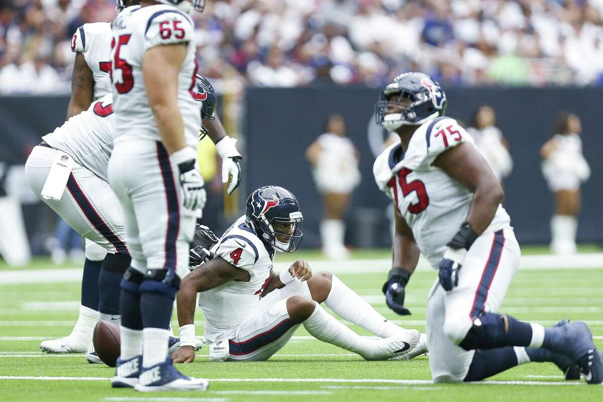 Houston Texans quarterback Deshaun Watson (4) gets up off the ground after he was sacked during the second half as the Houston Texans take on the New York Giants at NRG Stadium Sunday Sept. 23, 2018 in Houston.