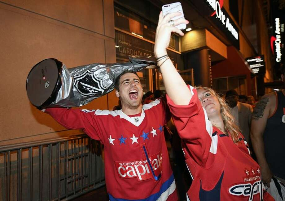 Washington Capitals fans celebrate in the streets outside Capital One Arena in Washington after Game 5 of the NHL hockey Stanley Cup Final between the Washington Capitals and the Vegas Golden Knights in Las Vegas, on June 7, 2018. The Capitals won the Stanley Cup. (AP Photo/Nick Wass)