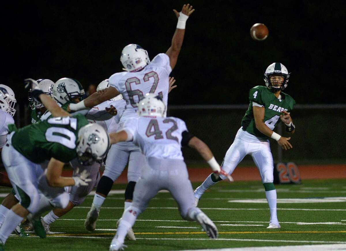 Bears QB #4 Kyle Gordon throws to an open receiver as the Norwalk High School Bears take on the Greenwich High School Cardinals in the FCIAC football game Friday, September 27, 2018, in Norwalk, Conn.