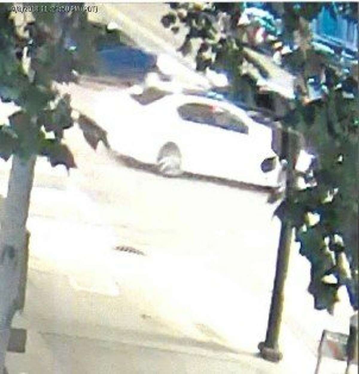 Police are asking the public's help in identifying a suspect who punched a man, causing severe head injuries, in San Francisco on the night of Sept. 8. Police released a sketch of the suspect and images of the white car he fled in.