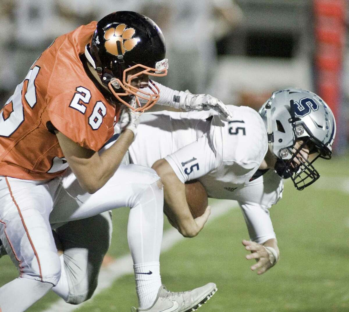 Ridgefield High School's Luke Faillaci tries to bring down Staples High School's Jake Thaw in a game played at Ridgefield. Friday, Sept. 28, 2018