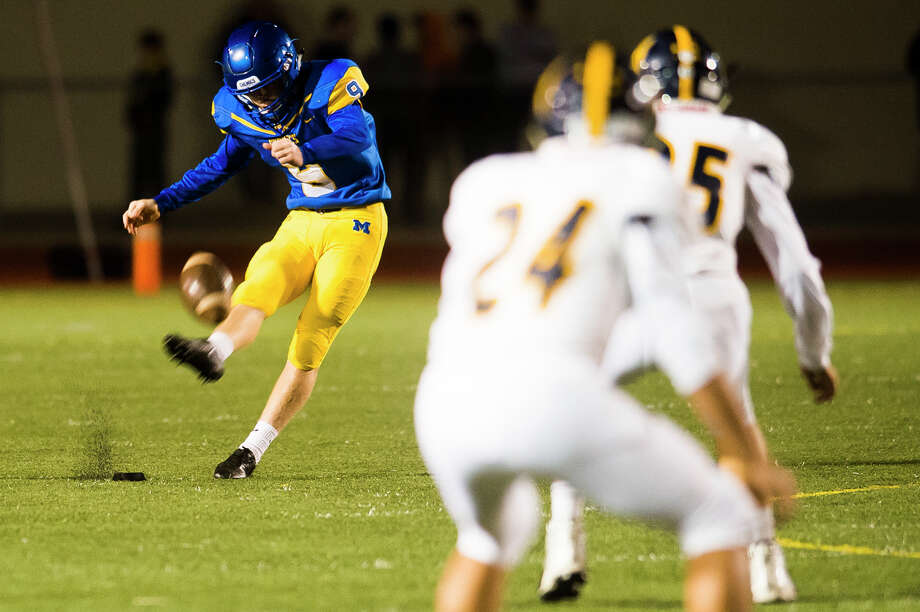 Midland junior Maxx Fisher takes a kick-off during the Chemics' game against Mt. Pleasant on Friday, Sept. 28, 2018 at Midland Community Stadium. (Katy Kildee/kkildee@mdn.net) Photo: (Katy Kildee/kkildee@mdn.net)