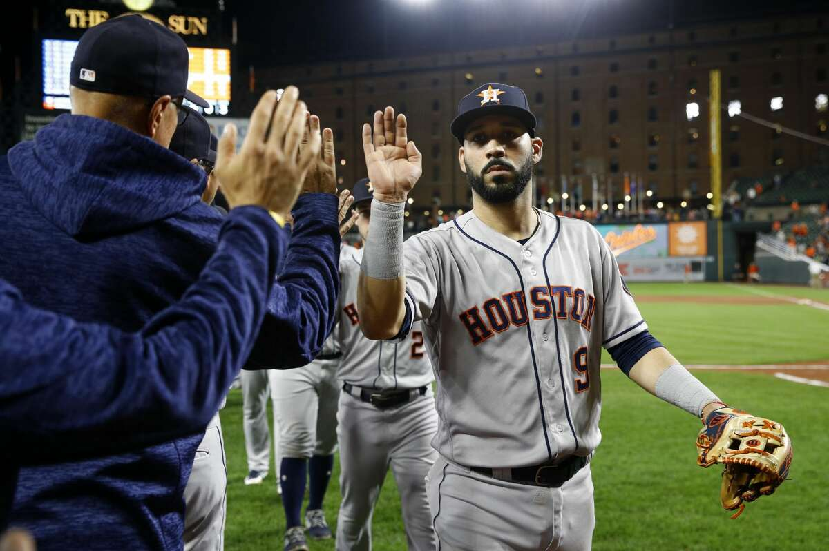 Houston Astros' Marwin Gonzalez high-fives teammates and coaches after a baseball game against the Baltimore Orioles, Friday, Sept. 28, 2018, in Baltimore. (AP Photo/Patrick Semansky)