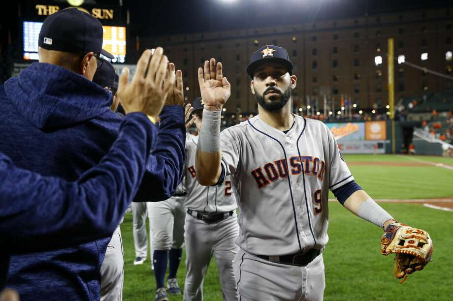 Houston Astros' Marwin Gonzalez high-fives teammates and coaches after a baseball game against the Baltimore Orioles, Friday, Sept. 28, 2018, in Baltimore. (AP Photo/Patrick Semansky) Photo: Patrick Semansky/Associated Press