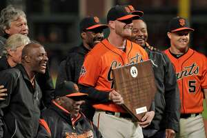 Will Smith poses for a photo with Willie McCovey and other award winners after being named the 2018 Willie Mac Award winner before the San Francisco Giants played the Los Angeles Dodgers at AT&T Park in San Francisco, Calif., on Friday, September 28, 2018.
