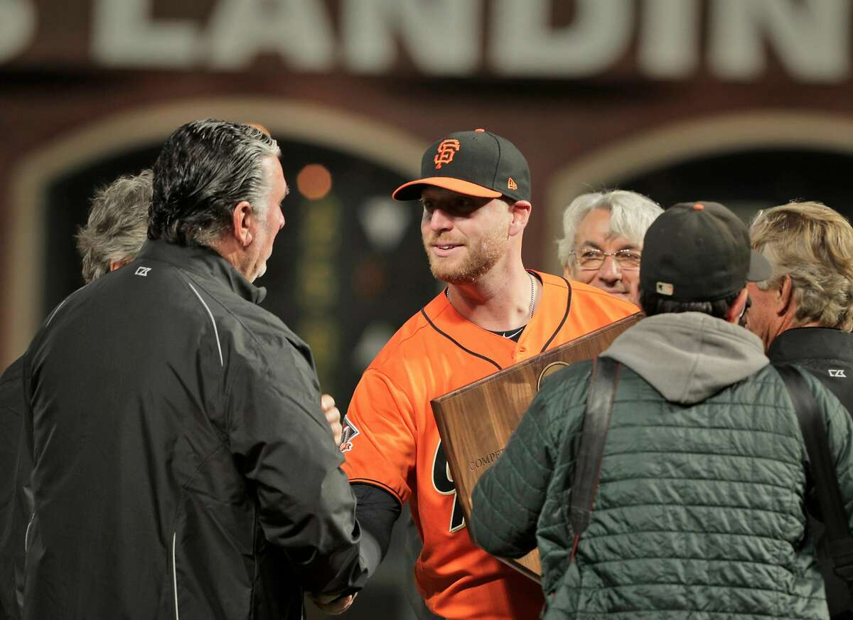 Will Smith shakes hands with Jack Clark after being named the 2018 Willie Mac Award winner before the San Francisco Giants played the Los Angeles Dodgers at AT&T Park in San Francisco, Calif., on Friday, September 28, 2018.
