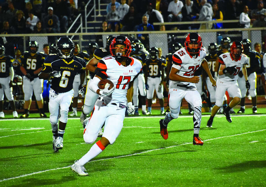 Edwardsville defensive back Ethan Young (No. 17) returns an interception for a touchdown in the opening minutes of Friday's Southwestern Conference game at O'Fallon. Photo: Matthew Kamp
