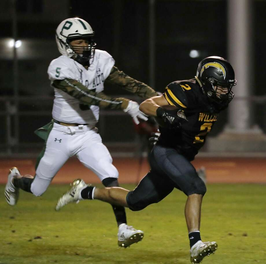 Wilcox's Paul M Rosa (2) runs a touchdown against Palo Alto's Damion Richard-Valencia (5) in the first quarter at Wilcox High School on Friday, Sept. 28, 2018, in Santa Clara, Calif. Photo: Jim Gensheimer / Special To The Chronicle