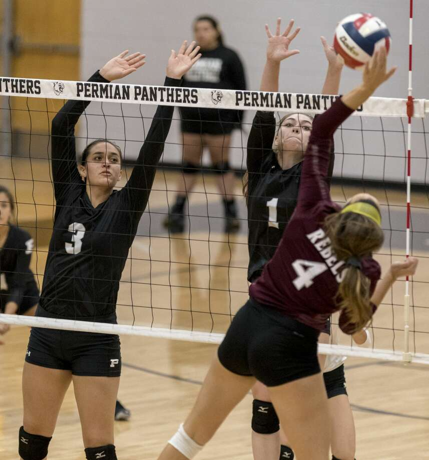 Noemi Marquez (3) and Lauren Lucas (1) attempt a block Friday night at Permian Field House. Photo: Jacy Lewis/191 News