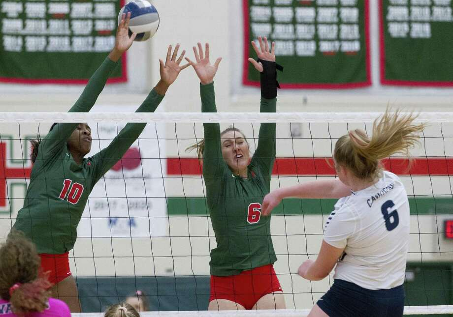 College Park's Annie Cooke (6) gets a shot past The Woodlands' Amanda Ifeany (10) and Courtney Heiser (6) during the first set of a District 15-6A high school volleyball match at The Woodlands High School, Friday, Sept. 28, 2018, in The Woodlands. Photo: Jason Fochtman, Houston Chronicle / Staff Photographer / © 2018 Houston Chronicle