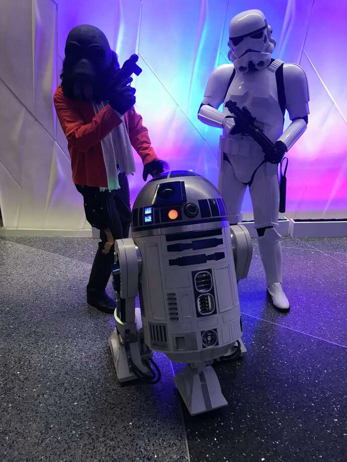 "Costumed characters from ""Star Wars"" prowl the Tobin Center lobby Friday night ahead of the San Antonio Symphony's movie concert. Photo: David Hendricks /Contributor"