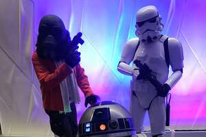 """Costumed characters from """"Star Wars"""" prowl the Tobin Center lobby Friday night ahead of the San Antonio Symphony's movie concert."""