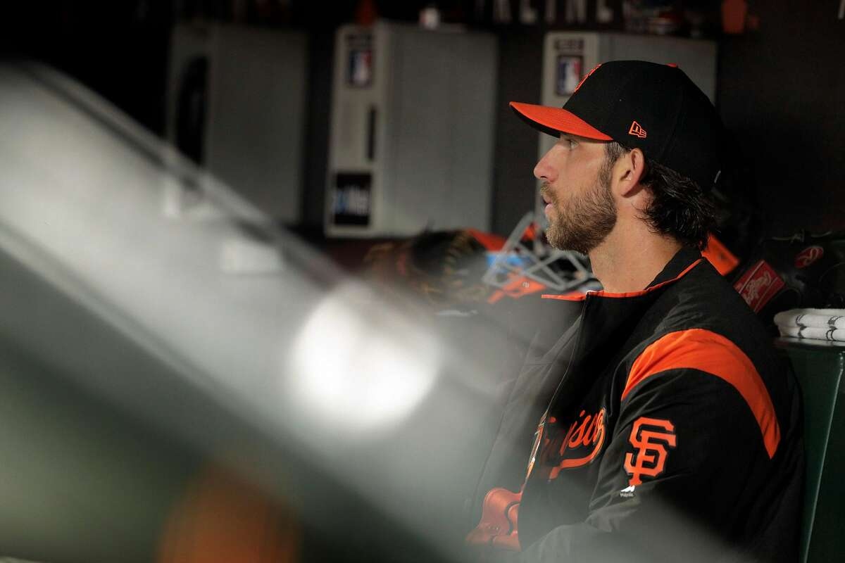Madison Bumgarner (40) sits in the dugout in the second inning as the San Francisco Giants played the Los Angeles Dodgers at AT&T Park in San Francisco, Calif., on Friday, September 28, 2018.