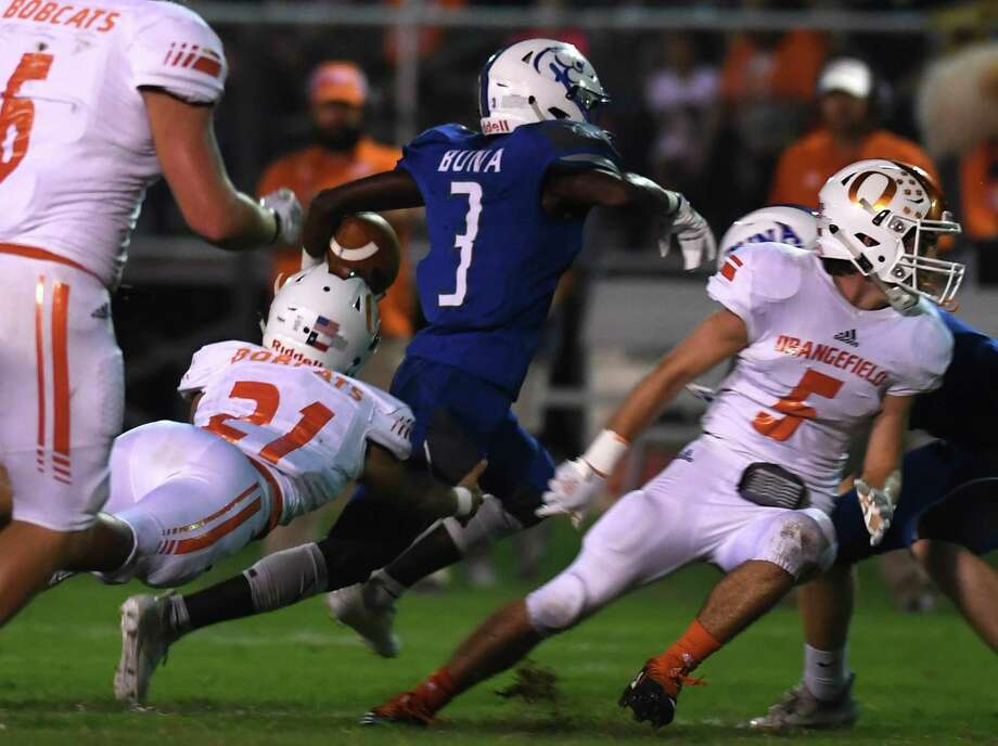 Buna's Kameron Richardson runs the ball for a touchdown against Orangefield at the Cougar's stadium Friday night.