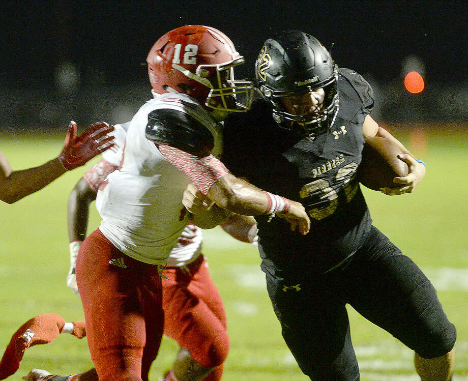 Vidor's Kelby Odom pushes back against Crosby's Vernon Heartfield, Jr., as he powers his way toward a touchdown during their district match-up Friday in Vidor.