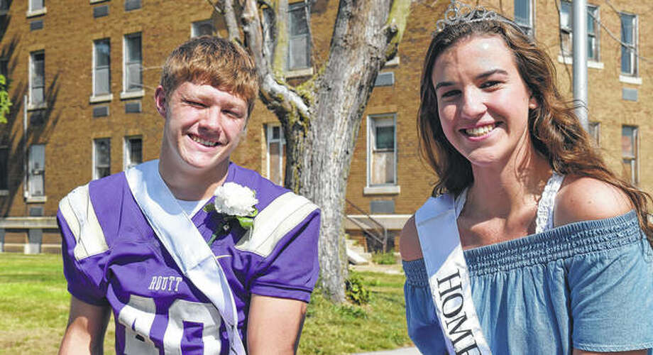 Routt Catholic High School homecoming king Dylan Marshall (left) and homecoming queen Katie Abell ride Friday in the school's homecoming parade. Dylan is the son of Aaron and Nikki Marshall and Katie is the daughter of Jeff and Kristy Abell. (For more photos from the parade, see the slideshow at myjournalcourier.com.) Photo: Greg Olson | Journal-Courier