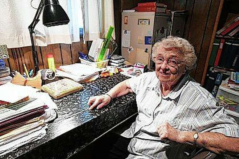 Long-time teacher Joyce Emmons sits in her tutoring room, surrounded by teaching materials in her home in Manteno. She retired from teaching just before she turned 80. She was set to retire sooner, but after her husband died, she decided to continue teaching. Photo: Tiffany Blanchette | Daily Journal (AP)