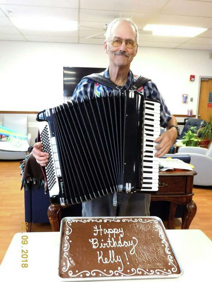 Every Tuesday, Kelly Gainor plays his accordion for the residents at the Harbor Beach Community Hospital Lakeview Extended Care and Rehab. They enjoy listening to his polkas, waltzes and variety of music that he plays that fills the room and halls. There is a lot of toe tapping and dancing that goes on when he is there. This was a special day for Gainor as it was his 75th birthday, so a cake was made in his honor and everyone sang happy birthday to him and enjoyed the birthday cake. (Submitted Photo)