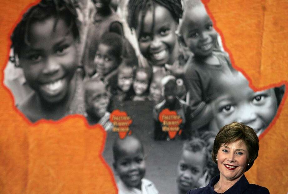 Laura Bush visited Mozambique in 2007. This week, Melania Trump is making her own journey to several nations in Africa. Photo: Themba Hadebe / Associated Press 2007