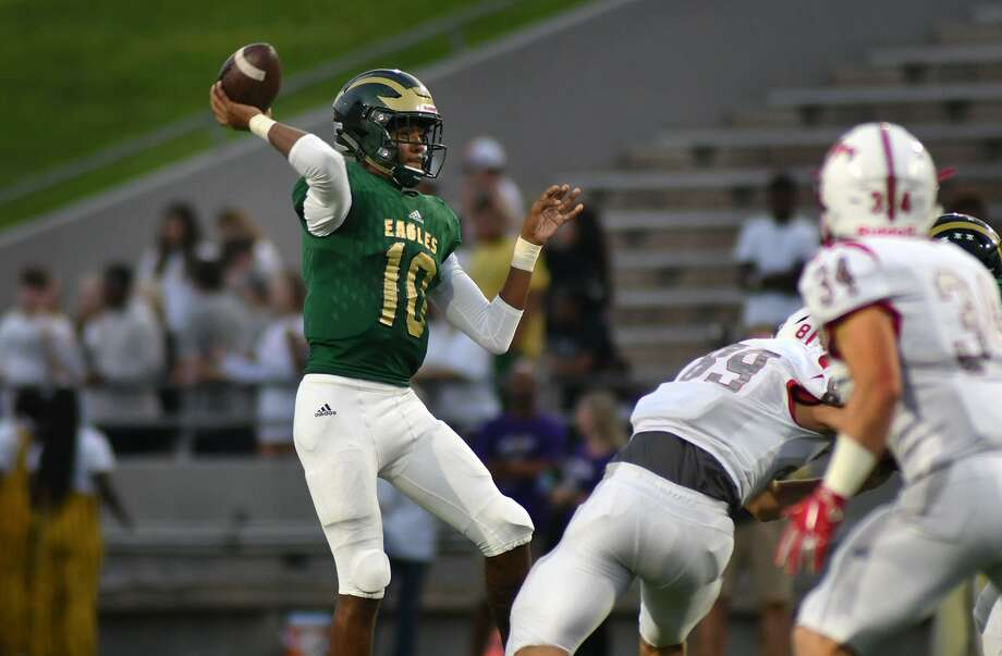 Cy Falls senior quarterback TJ Goodwin, left, signed his letter of intent to play college football at UTEP on Dec. 19. Photo: Jerry Baker, Houston Chronicle / Contributor / Houston Chronicle