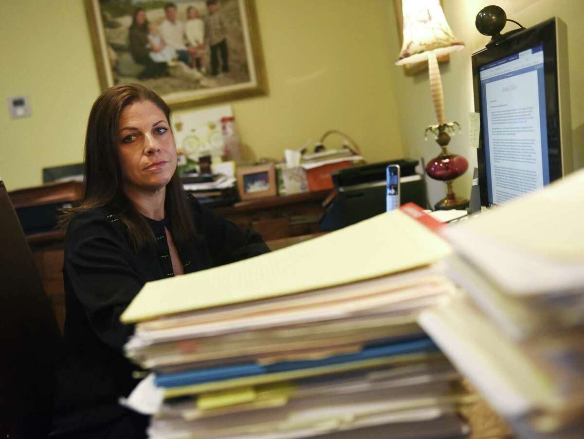 Attorney Alessandra Messineo Long poses at her home office in the Riverside section of Greenwich, Conn. Tuesday, Sept. 25, 2018. Long represents a client who says she was sexually abused by two teachers at The Loomis Chaffee School in the 1980s, and she and her client have been active in seeking justice and naming her alleged abusers.