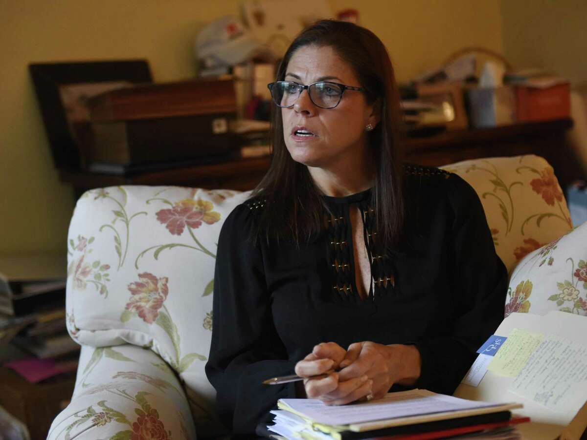 Attorney Alessandra Messineo Long speaks at her home office in the Riverside section of Greenwich, Conn. Tuesday, Sept. 25, 2018. Long represents a client who says she was sexually abused by two teachers at The Loomis Chaffee School in the 1980s, and she and her client have been active in seeking justice and naming her alleged abusers.
