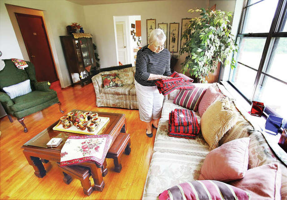 Becky Pate arranges some of the items that will be for sale in the new Wesley House Hearts-n-Mission Resale Shop, which is located in a house at 4501 Wesley Way in Godfrey. The house stands alone on the entrance road to United Methodist Village and is expected to open Oct. 6. Photo: John Badman | The Telegraph