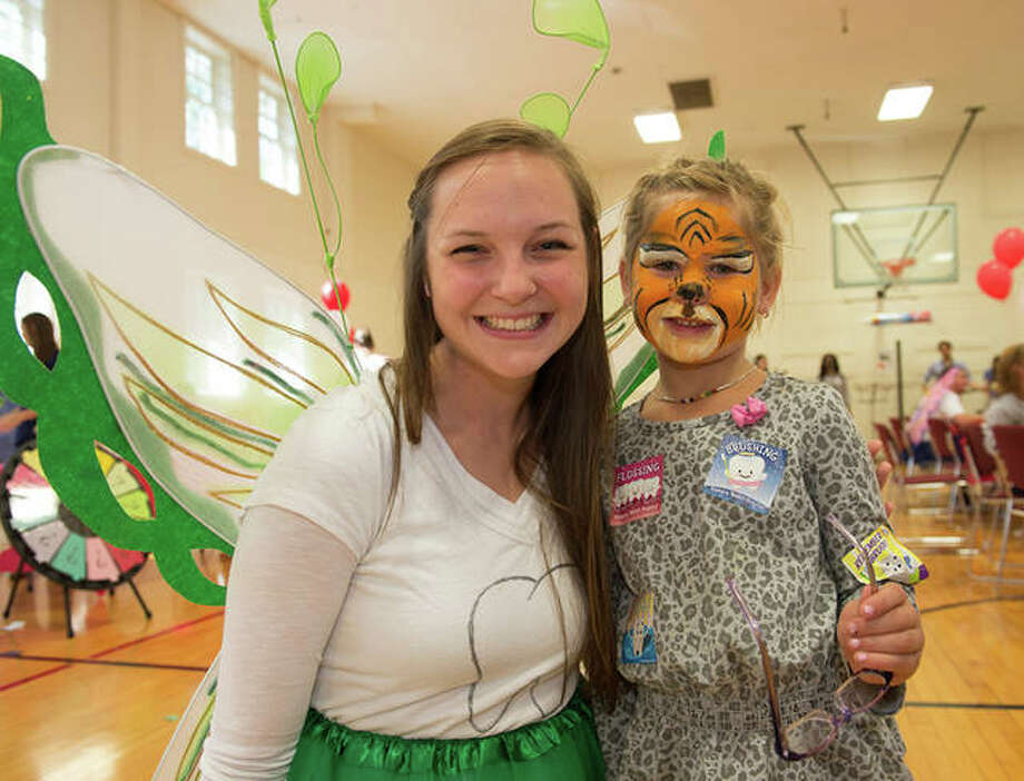 The tooth fairy entertains a young patient at a past SIU School of Dental Medicine's Give Kids a Smile Day. Photo: For The Telegraph