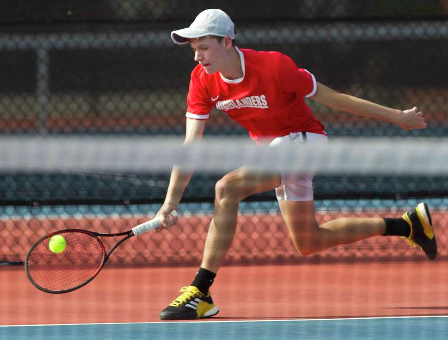 Lachlan Laner of The Woodlands returns a hit a in the boys singles finals during the District 12-6A tennis tournament at The Woodlands High School, Thursday, April 5, 2018, in The Woodlands. Photo: Jason Fochtman, Staff Photographer / Houston Chronicle / © 2018 Houston Chronicle
