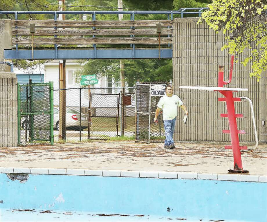 An employee of Wegman Electric was walking the now-closed Wood River Aquatic Center this week and taking notes about electrical setups and wiring as part of early preparations to raze the facility. The city is now considering alternative sources of revenue, including a possible 1 percent sales tax, to continue to offer some services, and possibly offer more in the future, in the face of declining population and income loss. Photo: John Badman | The Telegraph