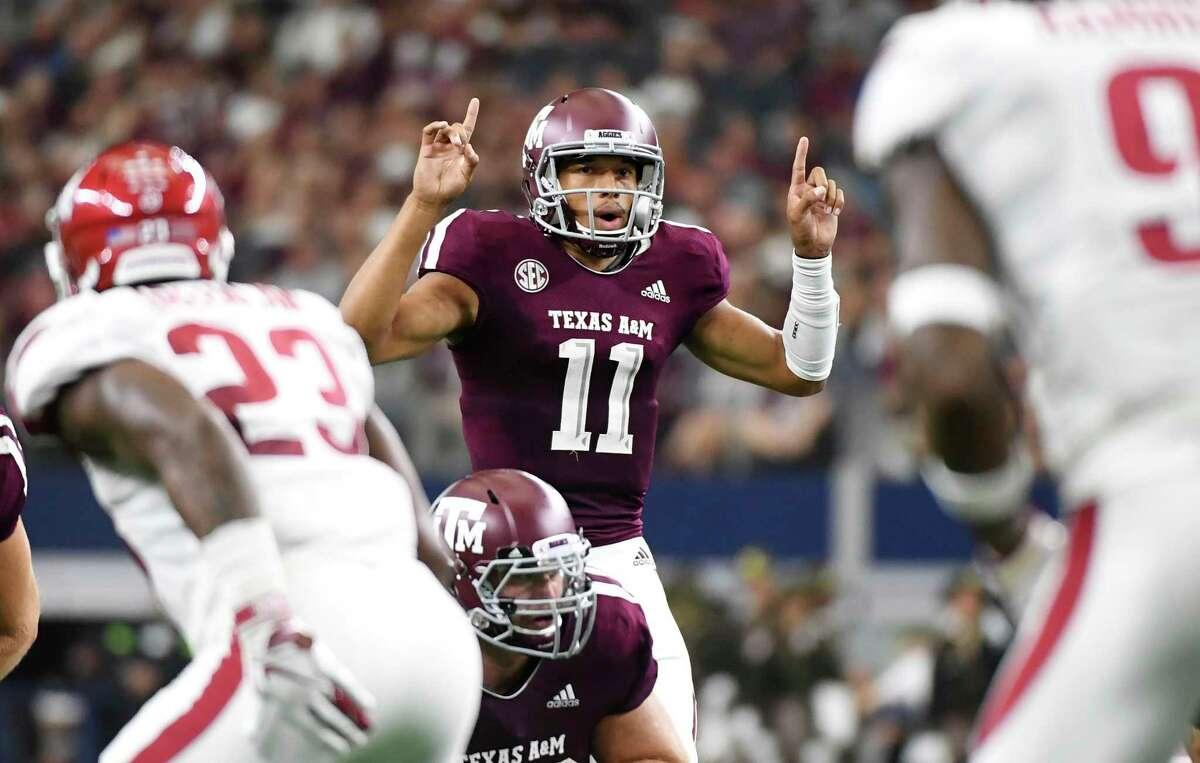 Texas A&M quarterback Kellen Mond (11) signals to his team during the second quarter of an NCAA college football game against Arkansas, Saturday, Sept. 29, 2018, in Arlington, Texas. (AP Photo/Jeffrey McWhorter)