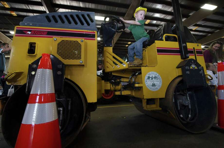 Liam Flaherty, 3 from Norwalk, sits atop a Stone Roller during The Norwalk Fire, DPW, Police, and EMS Open House and Touch-a-Truck event Saturday, September 29, 2018, at the Department of Public Works facility on South Smith Street in Norwalk, Conn. Photo: Erik Trautmann / Hearst Connecticut Media / Norwalk Hour