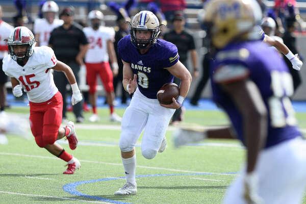 Midland High's Sean Porter runs the ball after making an interception against Harlingen Sept. 29, 2018, at Grande Communications Stadium. James Durbin/Reporter-Telegram