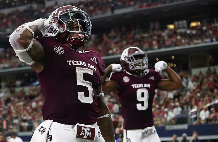 ARLINGTON, TX - SEPTEMBER 29:  Trayveon Williams #5 of the Texas A&M Aggies celebrates a touchdown run against the Arkansas Razorbacks during Southwest Classic at AT&T Stadium on September 29, 2018 in Arlington, Texas. Photo: Ronald Martinez, Getty Images / 2018 Getty Images