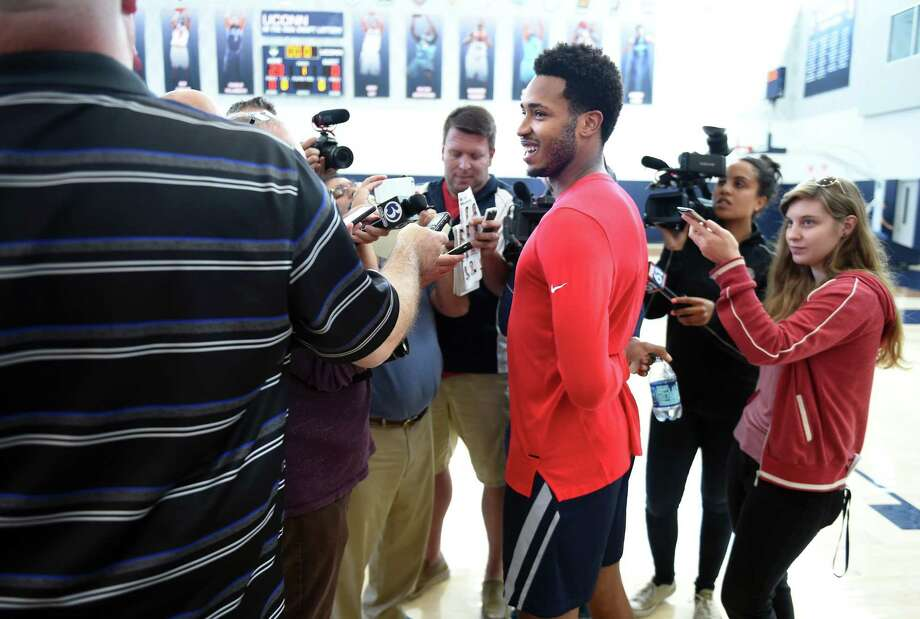 Jalen Adams (center) speaks to the media following the first day of practice for the UConn men's basketball team in Storrs on Saturday. Photo: Arnold Gold / Hearst Connecticut Media / New Haven Register
